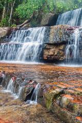 Fotobehang Watervallen Qubrada de Jaspe (Jasper Creek) is the river and a series of cascades in National Park Canaima, Venezuela. The water flows over a bedrock of jasper.