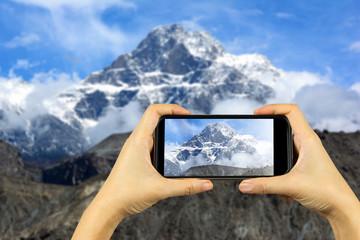 take photo by smart phone concept. Karakoram mountain range, him