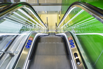 Top view of escalators, green color combination. panoramic angle of escalator