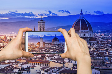 .Girl taking pictures on mobile smart phone in Duomo View of Flo