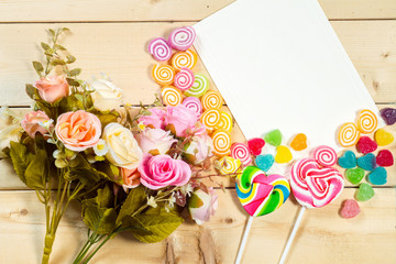 Roses flowers and empty tag for your text with heart shape candy