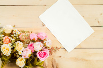 Roses flowers and empty tag for your text on wooden background