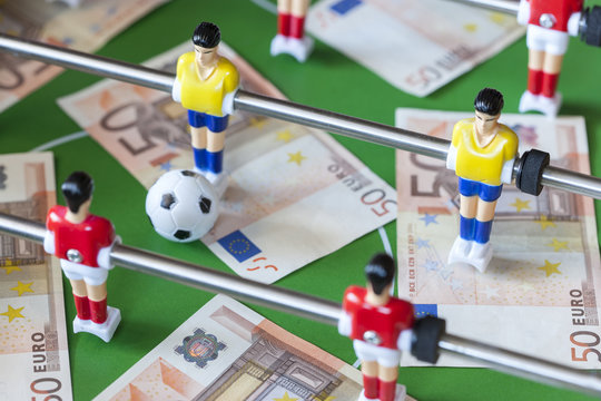 Sports and money. Concept about money spending in football (soccer), sports betting and manipulated fixed matches