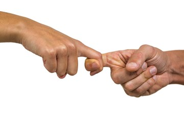 Cropped image of people holding fingers