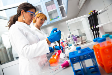 Photo of real female scientists researching in laboratory.