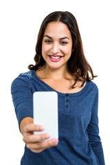 Pretty young woman taking selfie