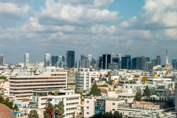 view of a modern city, city of Tel Aviv, in winter with clouds