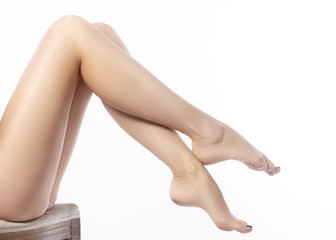 Beautiful female legs after depilation. Healthcare, foot care, rutine treatment. Spa and epilation. Sexy shape of woman's body. Part of female body. Feet with perfect clean smooth skin and pedicure.