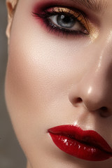 Beautiful model with fashion make-up. Close-up portrait sexy woman with glamour lip gloss makeup and bright eye shadows