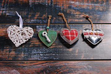 four different  hearts on shabby background