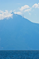 Silhouette of the holy mountains Athos with a cloud above the mountain top, Greece