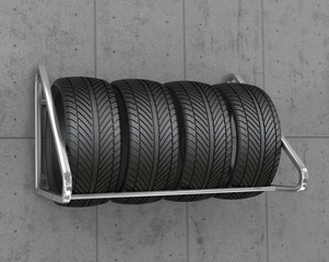 Tyres on the weight of the concrete wall.