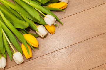 Beautiful tulips on wooden background with space for text. Selective focus. St. Valentines or love concept.