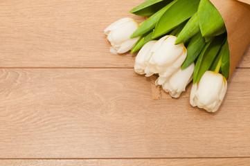 Fresh tulips flowers on wooden planks. Selective focus. St. Valentines or love concept.