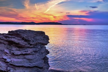 Magical Marquette Michigan Sunset. Sunset along the shores of Presque Isle Park in Marquette, Michigan. This beautiful park is located in the heart of Marquette. The Upper Peninsula's largest city. Wall mural