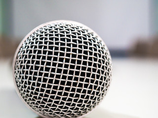 Microphone on white table in meeting room