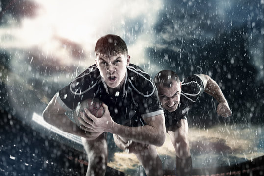 Rugby sportsmens, players run on a stadium