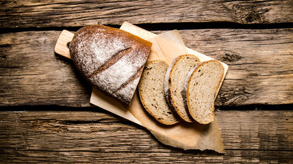 Sliced rye bread on a Board. On wooden table.