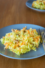 Savoy cabbage, brussels sprouts, apple, carrot and walnut salad on plate