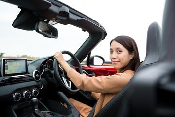 Woman driving a cabriolet car