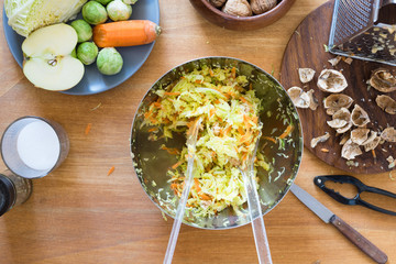 Mess on the table while preparing cabbage salad
