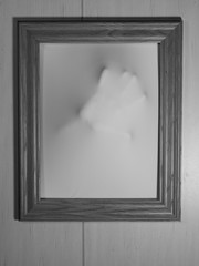 Creepy Bland and White Picture Frame with Something Coming Out of It