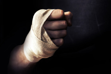 Hand Fist wrapped in bandage, fighting in fighter pose
