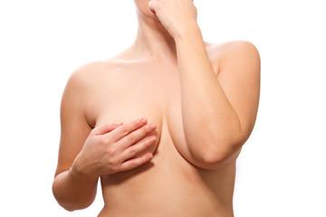 Schlank nackte Frau für die Brust berühren