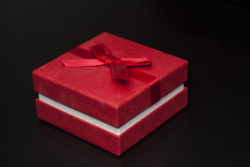 Red box gift on black background
