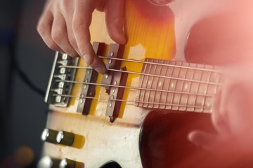 Close Up Playing Bass Guitar