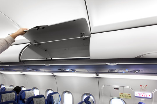 Airplane interior with luggage compartments