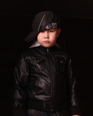 Boy in the image of a gangster rapper