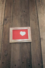 Picture frame with white heart for Valentine's Day