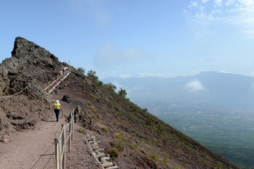 View of people hiking the rim of Mount Vesuvius volcano