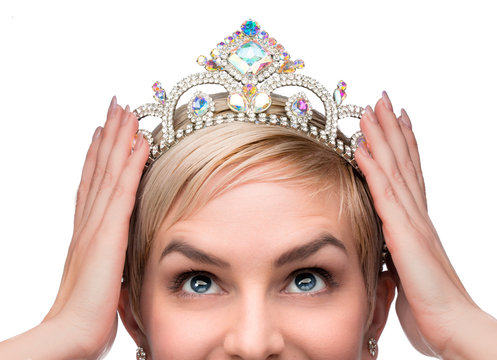 Beauty queen pageant winner placing tiara on head celebrating individuality independence courage and high self esteem