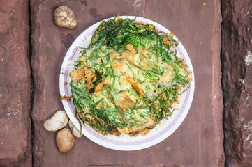 Thai Cuisine; cha-om omelet in white plate