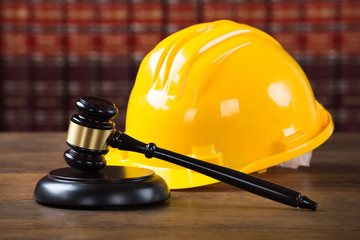 Mallet And Yellow Hardhat In Courtroom