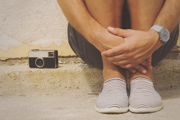 Hipster guy with old camera.