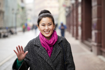 Young Asian woman walking on spring city in Russia