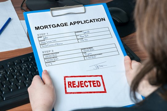 Mortgage application form with rejected stamp.