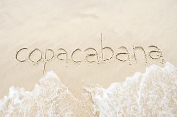 Copacabana, the famous beach, message handwritten on smooth sand in Rio de Janeiro, Brazil