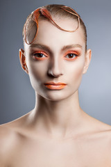 Creative make-up and hairstyle. Portrait of young girl