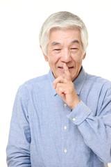 senior Japanese man whith silence gestures