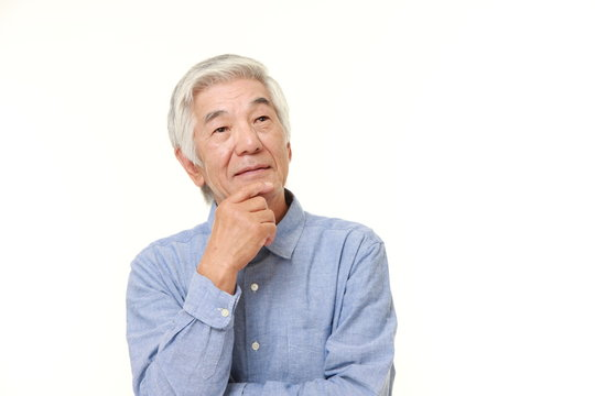 senior Japanese man dreaming at his future