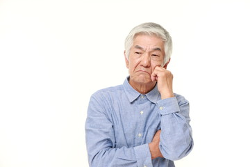 senior Japanese man worries about something