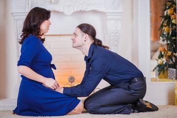 hugs pregnant couple