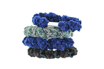 A stack of elastic head dressing, hair ties in blue and black