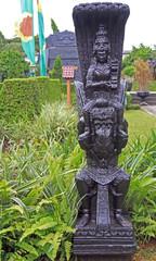 statue of indian god on garuda