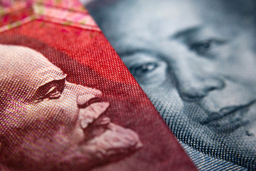 Close-up of an Russian ruble bill (showing Lenin) and a Chinese yuan banknote (Mao Zedong)