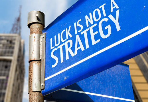 Luck Is Not a Strategy written on road sign